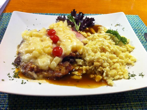 Schnitzel Hawaii topped with Pineapple and Melted Swiss Cheese
