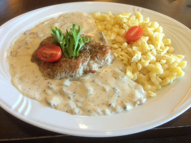 Roasted Pork Cutlet over a Creamy Mushroom Sauce